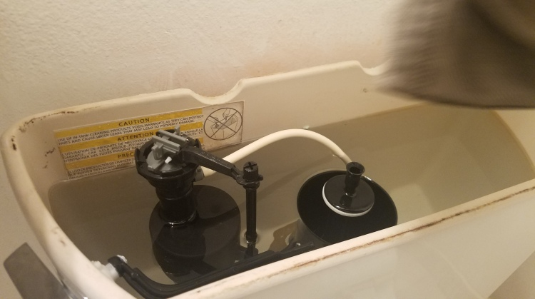 The little valve at the top of the tube on the left lets your toilet run all night.