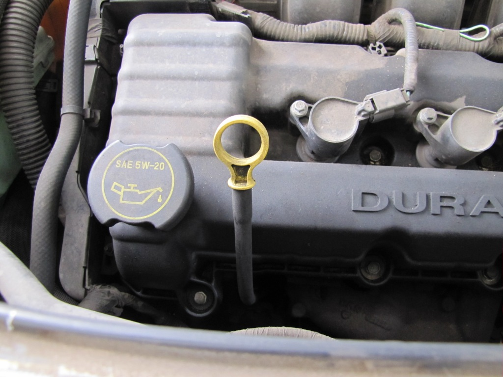 An engine oil dipstick and an oil-filler cap.