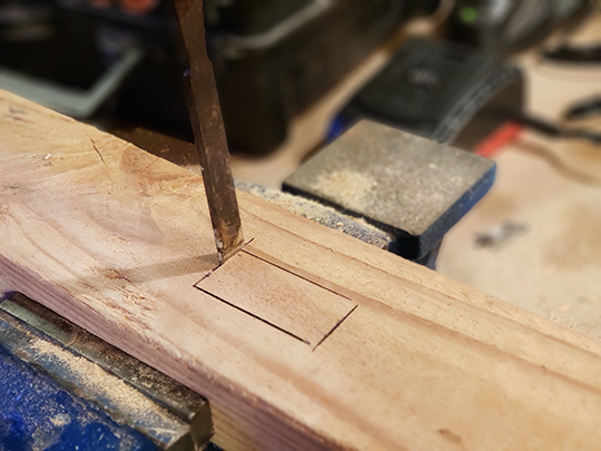 Make the first cut with the chisel perpendicular to the wood.