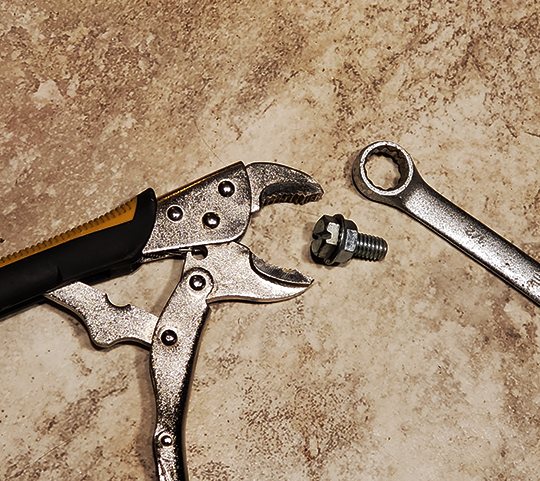 The best tool to loosen a bolt is a box end wrench, but sometimes you don't have the right size, or it can't reach. Enter the adjustable wrench.