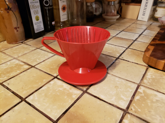 There's not much to the brew basket - it can be as simple as this one made from plastic. It features four holes at the bottom, which helps it drain a little faster than those with fewer holes.